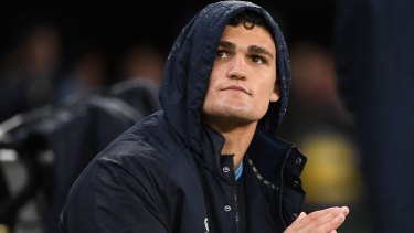 Sidelined: Nathan Cleary watches from the Blues bench after being forced off the field.