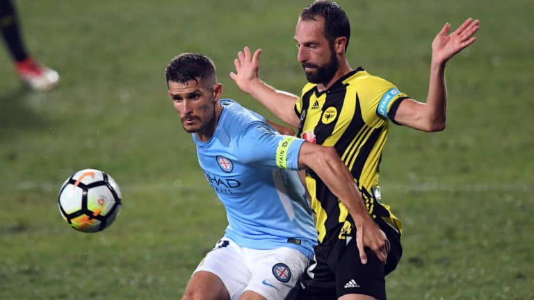 City's Dario Vidsic is challenged by Andrew Durante of the Phoenix.