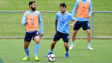 Potentially playing on: Sydney FC's Alex Brosque with Daniel De Silva at training.