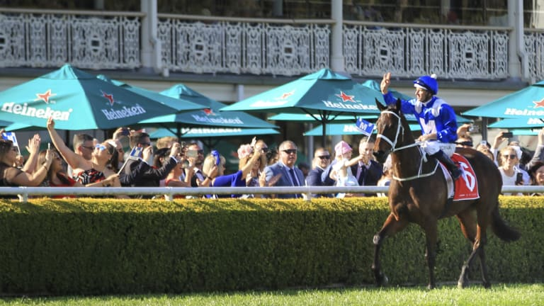 Unbeatable: Hugh Bowman salutes the crowd on Winx after she blitzed rivals  again for her 27th consecutive win.
