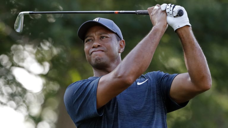 Brush with royalty: Tiger Woods at the PGA on Thursday.