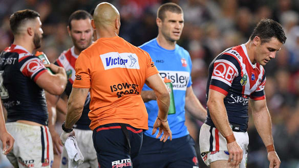 Cronk plays through injury as Roosters defence shuts down Rabbitohs