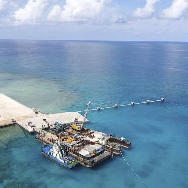 Ships carrying building materials docked at a new beach ramp at the Philippine-claimed island of Pag-asa, also known as Thitu, in the South China Sea in June, 2020.