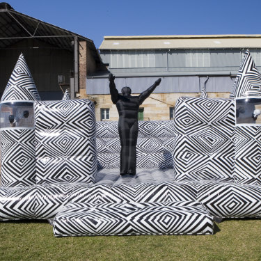"""Brook Andrew's """"Jumping Castle War Memorial"""" was so popular among 2010 Biennale of Sydney visitors, bouncing on it had to be banned."""