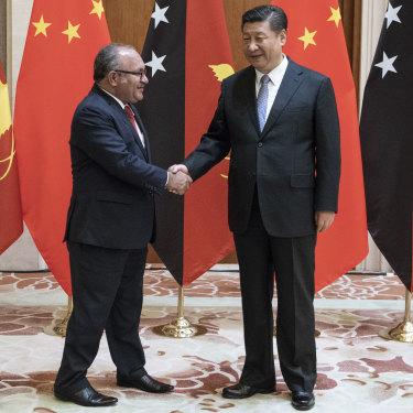PNG leader Peter O'Neill meets Xi Jinping in Beijing on June 21.
