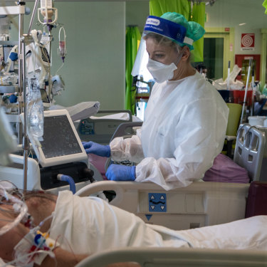 Dr Annalisa Malara next to a patient in the COVID-19 intensive care unit of the Ospedale Maggiore di Lodi.