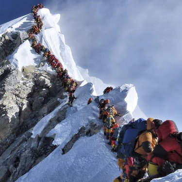 """Climbers on Everest on May 22 this year. Long delays increase the risk that climbers will run out of oxygen: """"If you've got to wait in a bloody queue, you're knocking on heaven's door,"""" says Australian climber Greg Mortimer."""