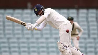 Cheteshwar Pujara in action against the Cricket Australia XI.