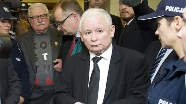 Poland's two most famous foes, the country's de facto leader, head of the ruling party Jaroslaw Kaczynski, right, and former President Lech Walesa, second left, stand near each other after exchanging wry comments before a courtroom in Gdansk, Poland, in November.