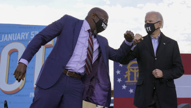 Democratic Senate candidate Raphael Warnock campaigning with President-elect Joe Biden at a rally in Atlanta.
