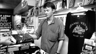 """""""Public demand for the book is at fever pitch..."""" A copy of The Satanic Verses is sold at The Busy Book shop, George Street on March 10, 1989."""