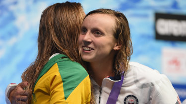 Rivals: Katie Ledecky hugs Ariarne Titmus on the podium.
