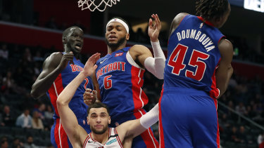 In the mix: Detroit Pistons forward Sekou Doumbouya (45) rebounds as Chicago Bulls guard Zach LaVine, bottom left, is pressured by Pistons forward Thon Maker (7) and guard Bruce Brown.