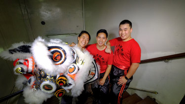 Emily Zee (left), Zhen Lim and Jordan Ta (right) will be performing in lion dances all around Melbourne this week.