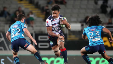 Lopeti Timani (centre) in action for the Rebels.