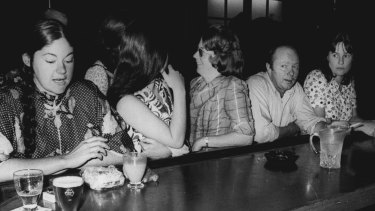 Members of the Women's Electoral Lobby invade a public bar in 1974.