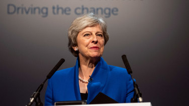 Theresa May delivers a speech at the Zero Emission Vehicle Summit in Birmingham on Tuesday.