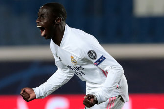 Ferland Mendy celebrates his late winner for Real Madrid.