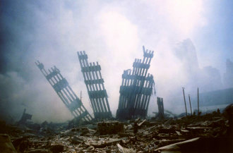 Ten days after the 9/11 terrorist attacks the remains of the World Trade Centre stand surrounded by debris.