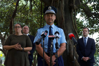Minister for Police and Emergency Services David Elliott, Assistant Commisioner Mark Jones and Attorney-General and Minister for the Prevention of Domestic Violence Mark Speakman address the media in March about domestic violence support services during lockdown.