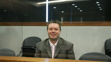 Carl Williams sits behind bullet-proof glass at Melbourne Magistrates Court in 2007.