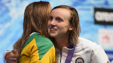 Rivals: Katie Ledecky hugs Ariarne Titmus on the podium.