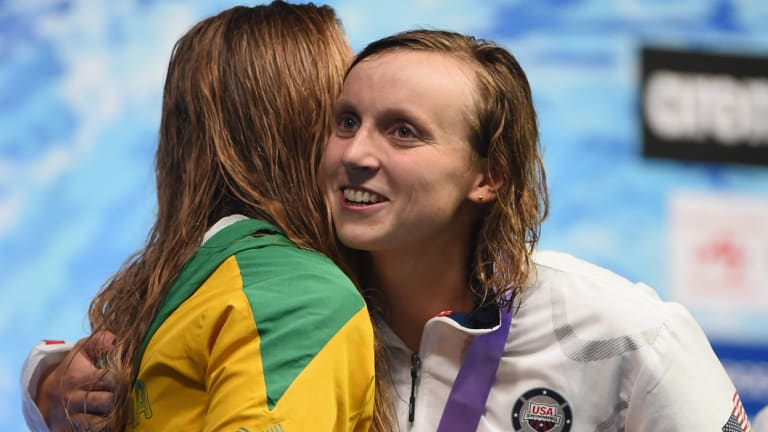 Beginning of a fine rivalry: Katie Ledecky hugs Ariarne Titmus on the podium.