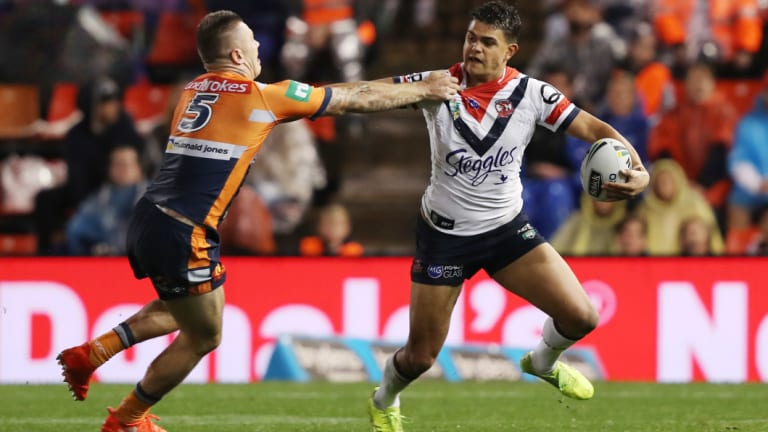 Pushing himself... and others: Latrell Mitchell's right-hand fend has been a sight to behold in 2018.