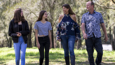 Newly elected MP for East Hills, Wendy Lindsay, with her husband John and daughters Lori and Ruby in the Georges River National Park near her home.