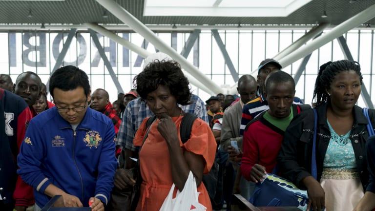 Chinese employees help passengers at the new Standard Gauge Railway terminal in Nairobi, Kenya.