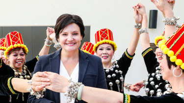 New NSW Labor leader Jodi McKay surrounded by local dancers in Burwood Park.