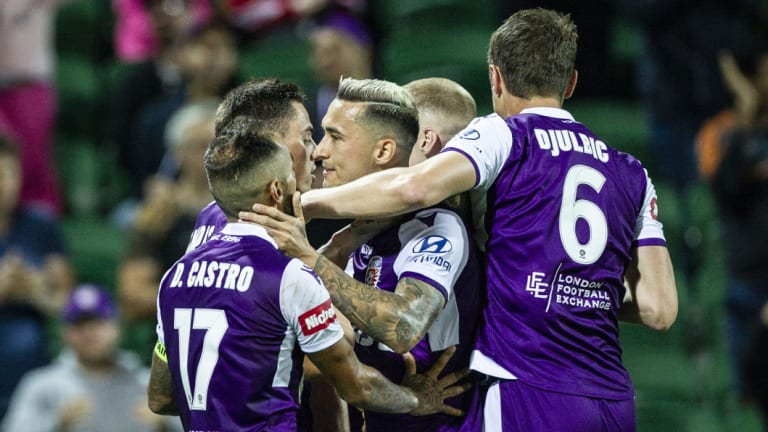Decisive: Perth Glory celebrate after Chris Ikonomidis pounced on a chance to break the deadlock against Melbourne City.