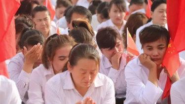 Ten thousand teachers in Hotan take part in a mass oath in Keriye County.