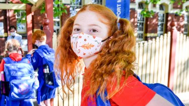 Mila picks her floral mask for the first day back at school after lockdown.