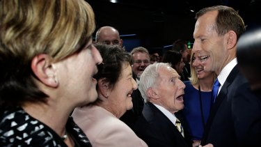 Tony Abbott greets his father Richard Abbott during the Federal Coalition campaign launch in August 2013.