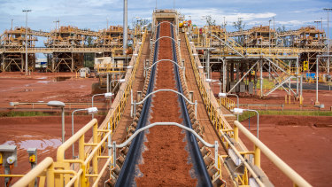 Tonnes of bauxite moves along a huge conveyor belt at Rio Tinto's new Amrun bauxite mine on Cape York, Queensland.