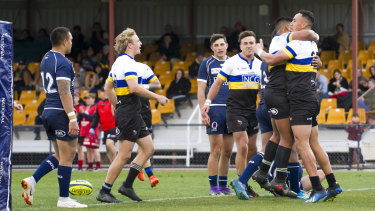 Forgotten competition: The Vikings' Lausii Taliauli celebrates a try in the NRC.