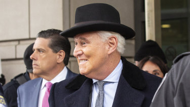 Roger Stone, former adviser to Donald Trump's presidential campaign, centre, exits federal court in Washington after being sentences to 3 years and 4 months in prison.
