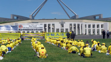 Falun Gong practitioners demonstrate outside Australia's Parliament House in Canberra in 2016.