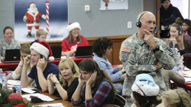 Hundreds of volunteers help answer the phone calls from children around the world as NORAD tracks Santa.