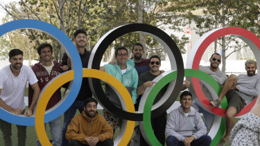 Tourists have their photo taken with the Olympic rings in Tokyo at the weekend.