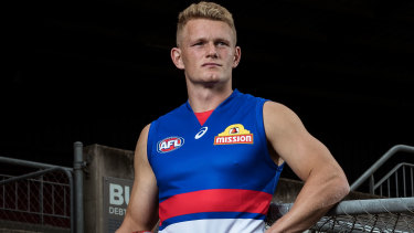 Adam Treloar tries out his new jersey.