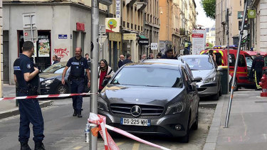 Police at the scene of a suspected bomb attack in central Lyon.