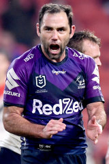 Cameron Smith celebrates kicking the winning goal for the Storm.