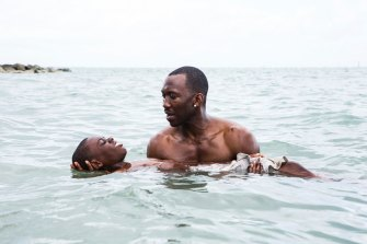 Alex Hibbert and Mahershala Ali in the scene from Moonlight that was reimagined through Britell's score.