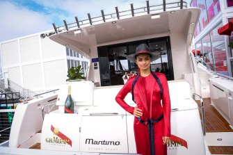 Model Shanina Shaik shows off the multimillion-dollar yacht that was implanted in the Mumm marquee in 2017.