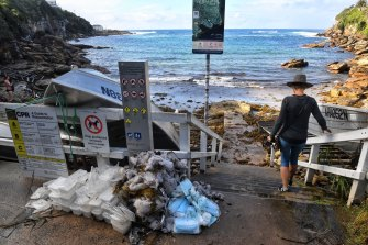 Council workers and SES have been collecting debris including surgical masks which have washed up near Gordons Bay.