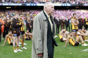 John Kennedy Sr stands with the Hawks after their 2012 grand final defeat.