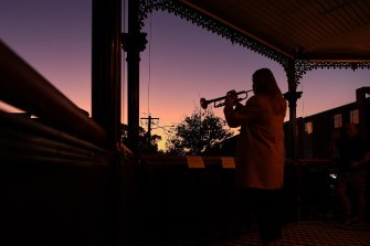 Sarah Brown, 23, plays The Last Post from the balcony of The Royal Hotel in Leichhardt.