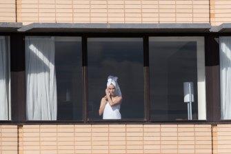 A returned passenger in hotel quarantine.
